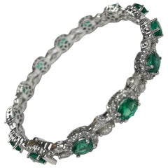 DiamondTown 6.25 Carat Oval Cut Emerald and Diamond Bracelet in 18k White Gold