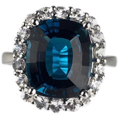 DiamondTown 7.29 Carat London Blue Topaz Ring with White Sapphire Halo