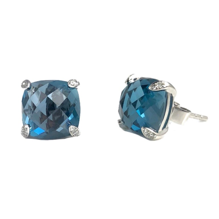 These beautiful earrings feature 7.92 carats cushion cut blue topaz. The prongs are embellished with 0.05 carats diamonds.  Set in 14k white gold, these earrings would be a welcome addition to any jewelry box.  Diamond Town is pleased to offer a