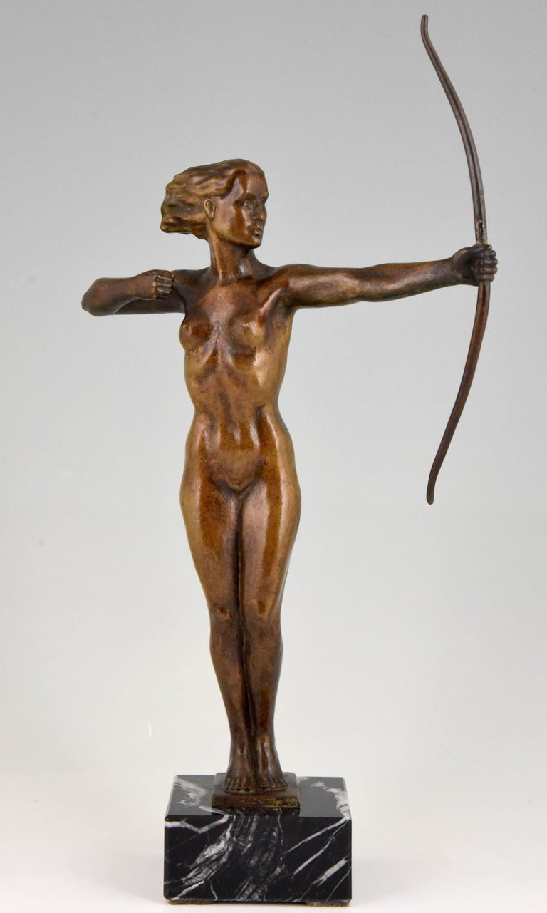 Very nice Art Deco bronze sculpture of a standing nude with bow. Monogram V. H. On marble base, circa 1930.