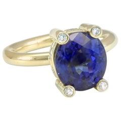 Diana Kim England 5.5 Carat Deep Color Tanzanite Ring with Diamonds in 18K Gold