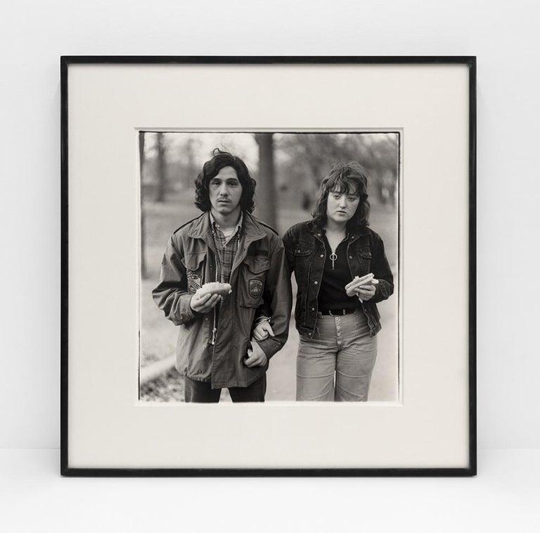 A young man and his girlfriend with hot dogs in the park, N.Y.C. 1971 - Photograph by Diane Arbus