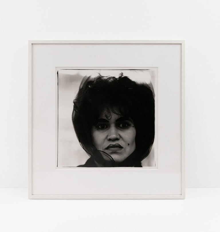 Puerto Rican woman with a beauty mark - Contemporary Photograph by Diane Arbus