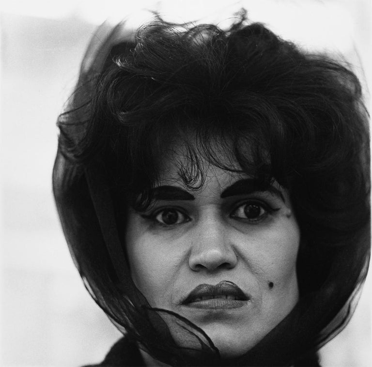 Puerto Rican woman with a beauty mark - Photograph by Diane Arbus