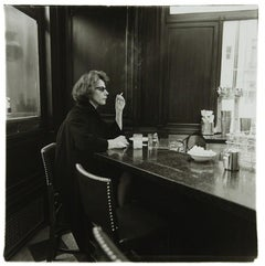 Woman at a counter smoking, N.Y.C. 1962