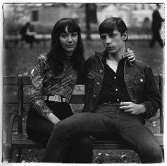 Young couple on a bench in Washington Square Park, NYC