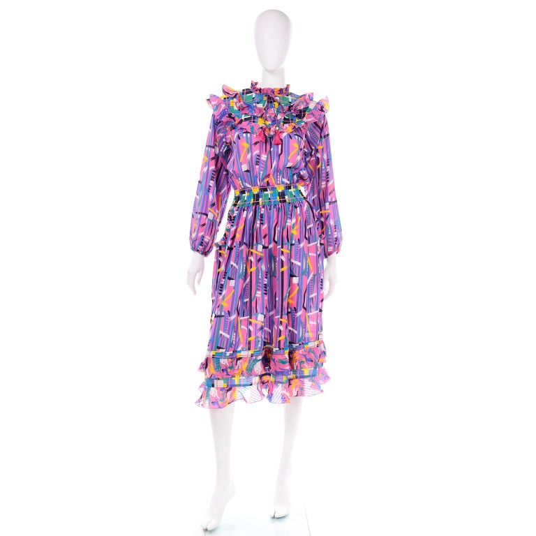 We love Diane Freis dresses because they were made to travel easily and to be worn by a range of sizes. This one is really unique with its gorgeous abstract pattern in pretty shades of pink, purple, yellow and blue.The fun  ruffles around the