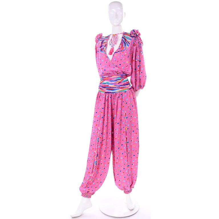 This is one of the coolest jumpsuits we've come across. Designed by Diane Freis in the 1980's, we love that her pieces are made specifically to fit on a wide range of sizes! This jumpsuit wraps in front and has an elastic waist.  The wide legs have