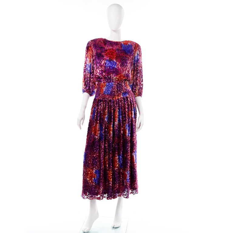 We are obsessed with this vintage Diane Freis Silk Dress! We adore the fabric and the open lattice work in the back! This gorgeous dress is 100% Silk and is made in a burnout velvet abstract watercolor pattern fabric with metallic accents.  The