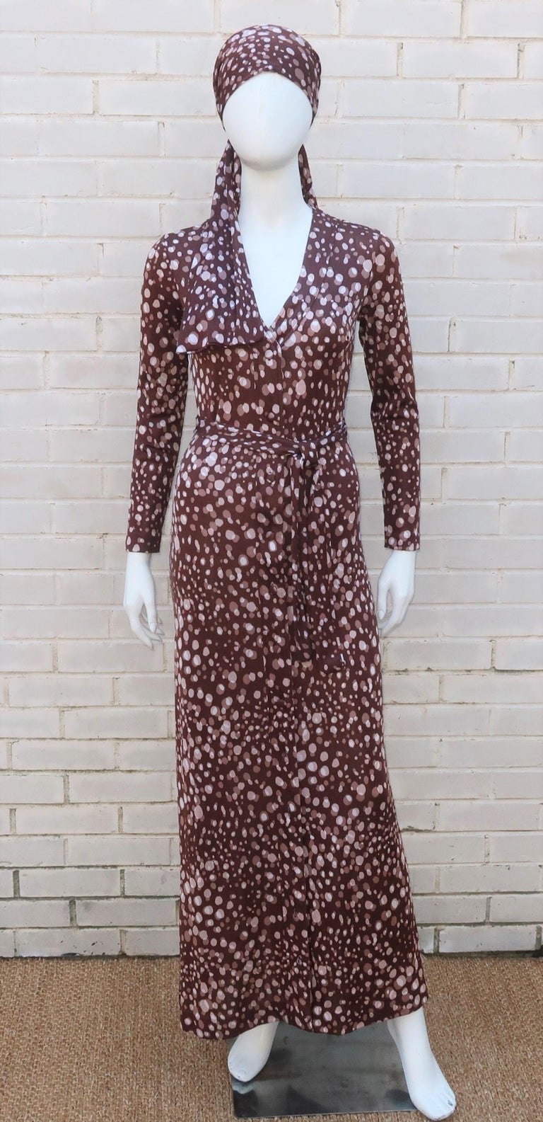 Early 1970's Diane Von Furstenberg maxi dress in a brown and ivory white abstract polka dot print.  The dress buttons all the way down the front with a coordinating sash belt and a scarf that can be worn at the neck or as a head wrap.  Originally
