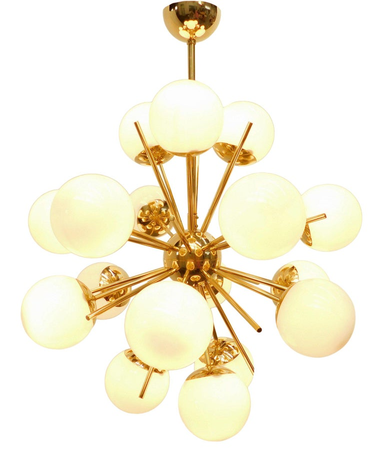 Italian chandelier shown in 18 glossy white Murano glass globes with 18 polished brass rods on polished brass frame 18 lights / E12 or E14 type / max 40W each Measures: Diameter 29 inches, height 32 inches Order only / Made in Italy. Order Reference