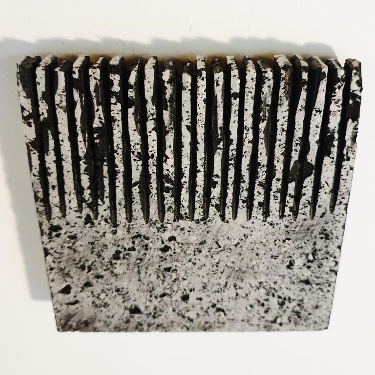o.T. (Bk15Hf) is a unique small size contemporary modern wall sculpture painting relief by German artist Dieter Kränzlein. The relief is made from limestone and the carved pattern is finished with a thin layer of black ink that has penetrated into