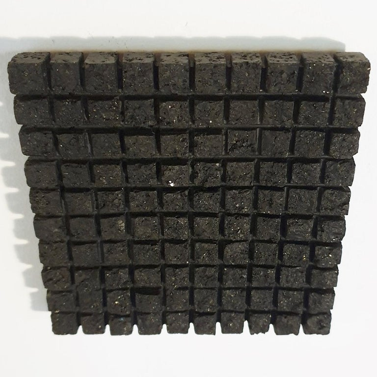 o.T. (Bk15Sq) is a unique small size contemporary modern wall sculpture painting relief by German artist Dieter Kränzlein. The relief is made from limestone and it is finished with a thin layer of black ink that has penetrated into the limestone.