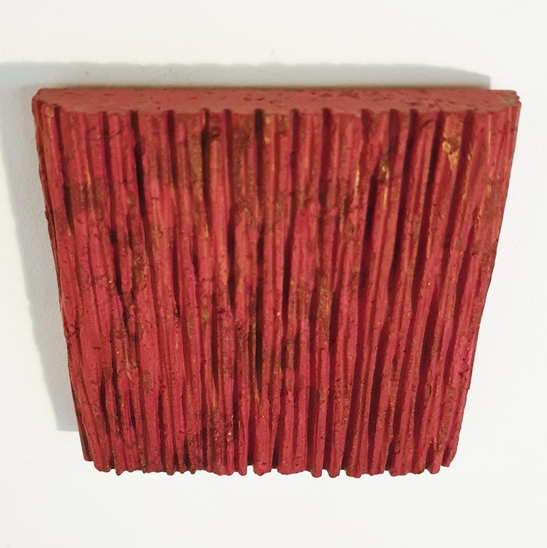 o.T. (Rd15Vt) is a unique small size contemporary modern wall sculpture painting relief by German artist Dieter Kränzlein. The relief is made from limestone and it is finished with a thin layer of red ink (and a touch of gold underneath) that has