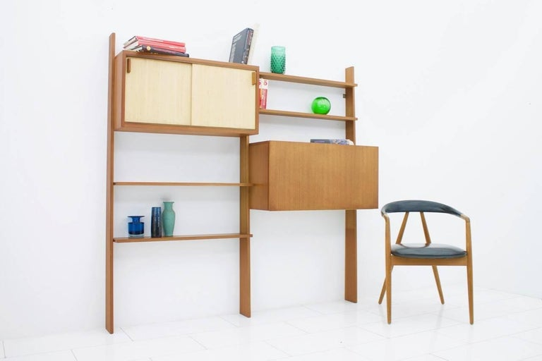 Rare teak shelf system by Dieter Waeckerlin with seagrass sliding doors.