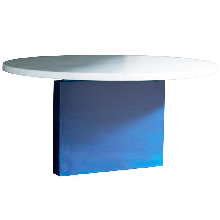 This table features a honed Carrara marble top with a sculptural, asymmetrical solid maple base with a hand lacquered finish. 