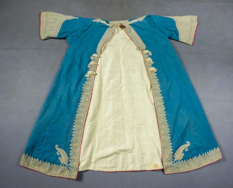 Second half of the 19th century India Punjab  Male coat of Indian dignitary called Choga and native of the Punjab region (Amristar) from the late nineteenth century. Very fine turquoise pashmina densely embroidered with Zari of cream silk thread