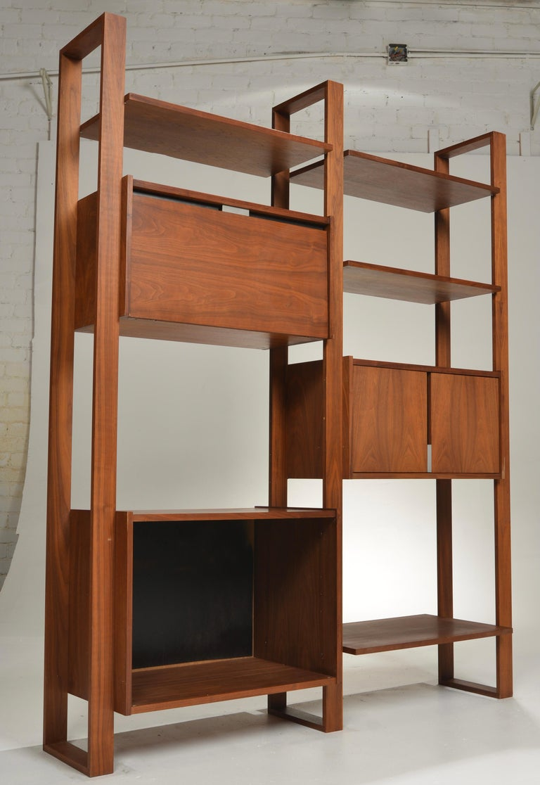 This is a beautifully crafted wall unit by Dillingham. The cabinets and shelves are modular and can be arranged as desired.