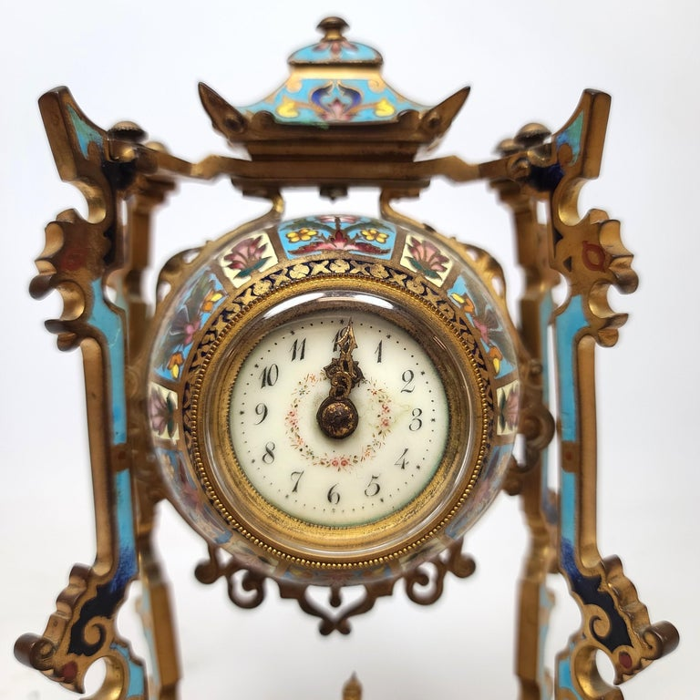 French 19th century diminutive chinoiserie champlevé clock set with a seated Buddha figure in the middle.