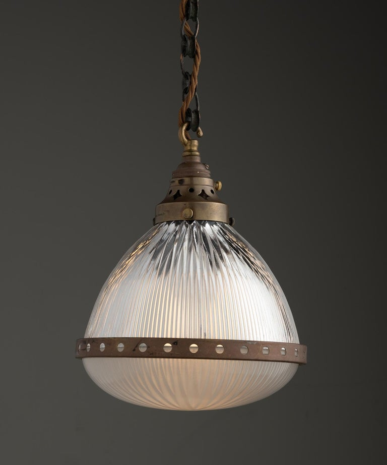 Etched glass holophane pendant with brass cage and fitter.