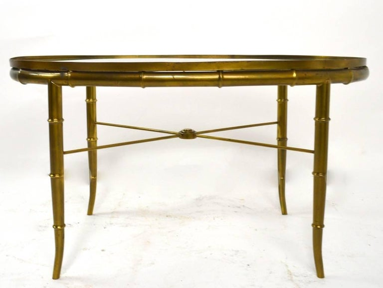 Oval brass faux bamboo base with plate glass insert top made by Mastercraft. Excellent, clean, original condition, ready to use.