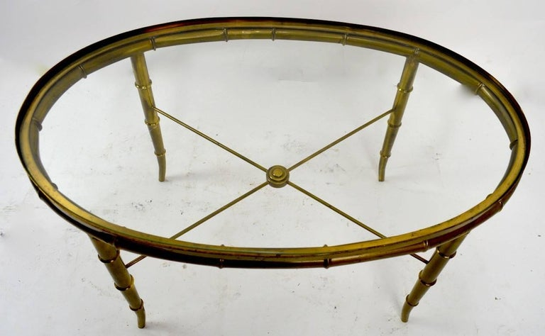20th Century Diminutive Oval Brass and Glass Coffee Table by Mastercraft For Sale