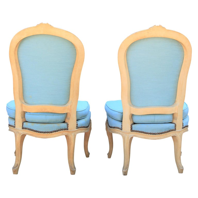 Diminutive pair of French carved painted wood slipper chairs. Perfect scale for a small space or occasional chairs. Currently in original usable fabric, however for perfection COM suggested. Custom finishing available.