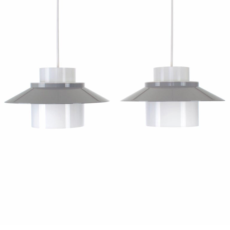 Dinette- pair of ceiling lights by Bent Karlby in 1970 and produced by Lyfa - Danish Modern lighting - gray and white acrylic lights in good vintage condition.  Pair of cute pendants cast in acrylic plastic with a white (translucent) inner core