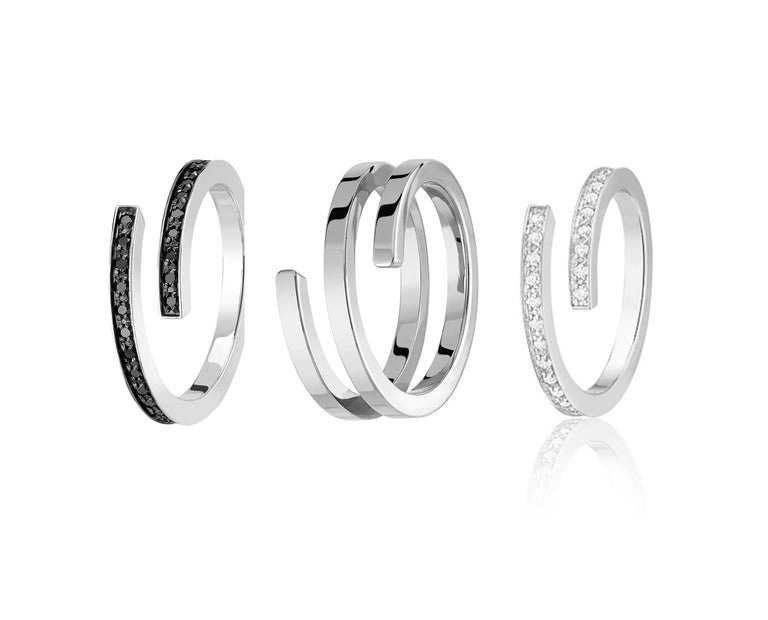 Set of 3 rings, a unique entwining design of 18kt gold rings.   In this collection by french jeweller Dinh Van, multiple combinations of different materials, different designs as well as different sizes are for you to mix and match. Its designed