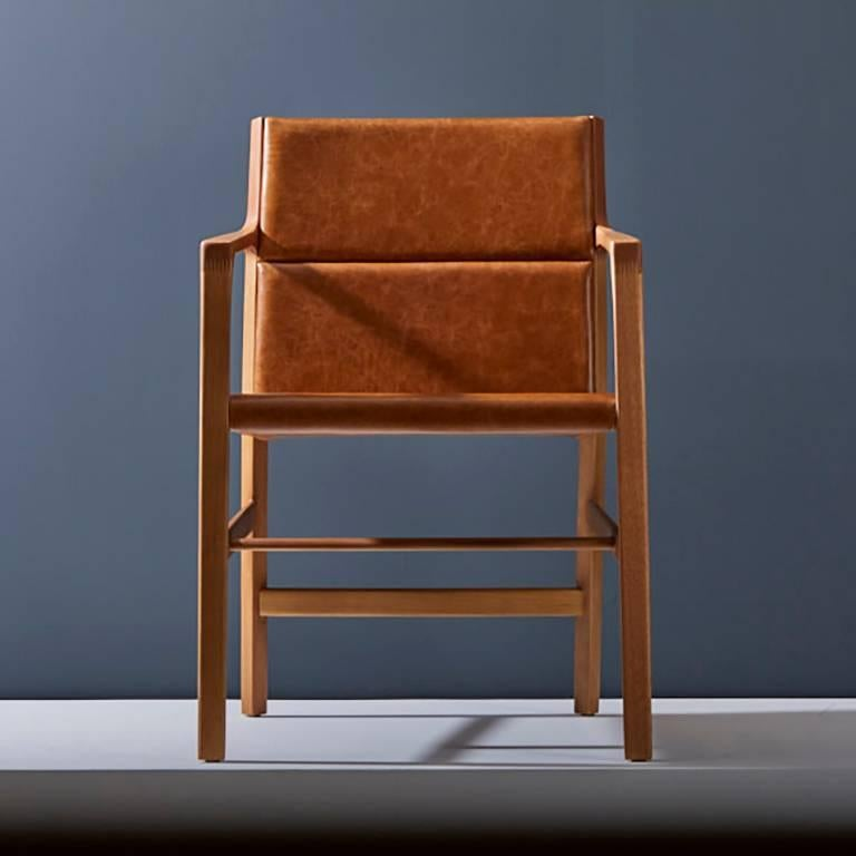 This dining room armchair is part of the Arrow collection, which carries the concept of precision and the figurative arrow element abstraction, present thru the design.  Using the halfway between organic and racional design approach, we used