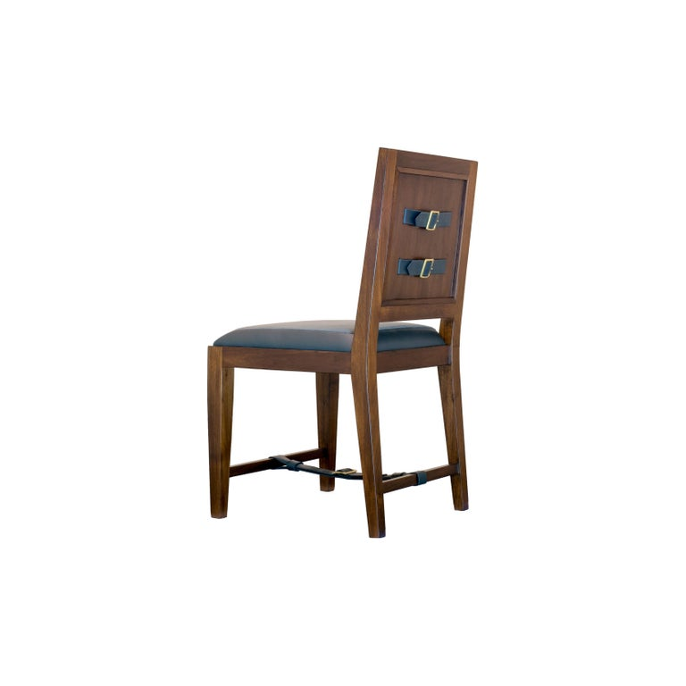 The solid walnut classic French dining and desk chair is handcrafted with traditional joinery. The upholstery features a combination of leather and fabric and is an homage to 1940s French designer Jacques Adnet. Custom sizes and finishes available.