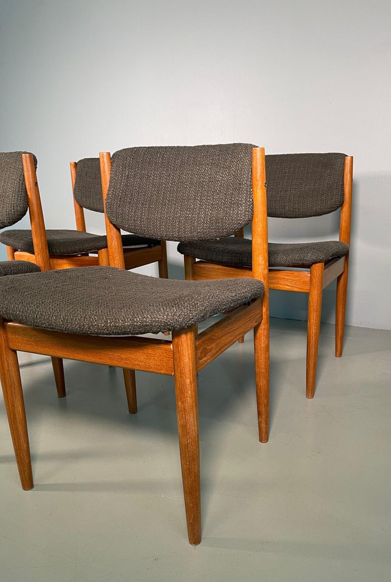 Set of 4 Scandinavian chairs designed by Finn Juhl and produced by France and Son in Denmark in the 1960s. They feature solid teak structures with original fabric seats and backs.