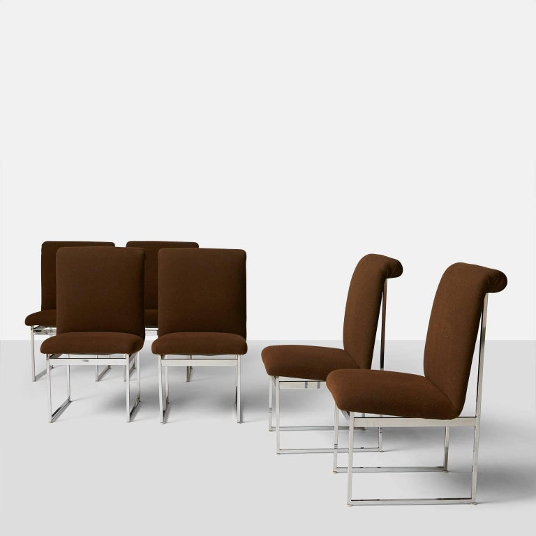 A set of six high back dining chairs in chromed steel and chocolate brown wool upholstery. The seat slants back slightly for extra comfort while the back has a rolled detail at the top. Made in the 1970s.