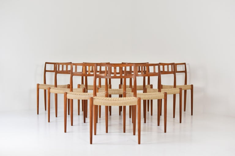 Large set of 10 dining chairs by Niels O. Møller for J.L. Møllers Møbelfabrik, Denmark, 1966. This is model 79 and is made out of solid teak. All chairs are professionally re-upholstered with new paper cord seats. Very good condition. Labeled