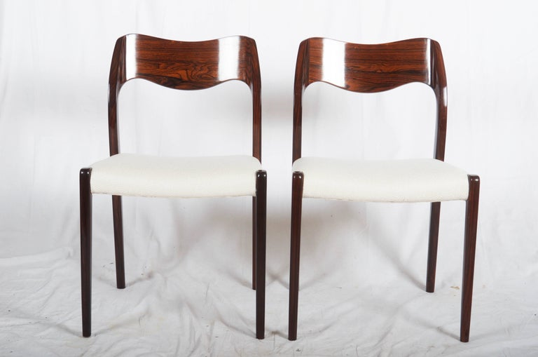 Dining chairs made of hardwood, designed 1951 by Niels Otto Møller and produced by J. L. Møller Møbelfabrik, model number 71. Excellent restored with new upholstered. (Another fabric or leather of course possible) Up to 12 available, delivery time