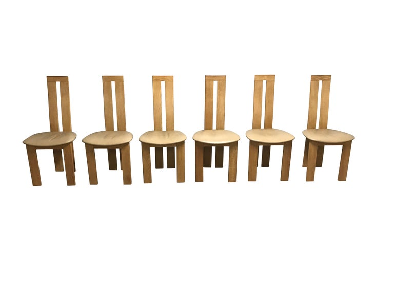Set of six Postmodern clear wooden and beige leather dining chairs designed by Pietro Costantini for Ello.