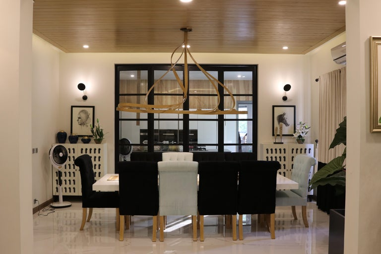 A chandelier made in solid ashwood using wood bending techniques. The piece is a complex design, giving it a varying look from each angle. Spotlights are placed under the structure creating a distinct lighting ambience. The natural curves of the