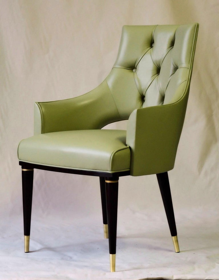 Highback and comfortable dining chair in Italian fiore leather. This successful dining chair is now offered in primo fiore leather. Here pictured in a soft midcentury sage green. Very difficult to picture It correspond to PANTONE 7493 C, that is