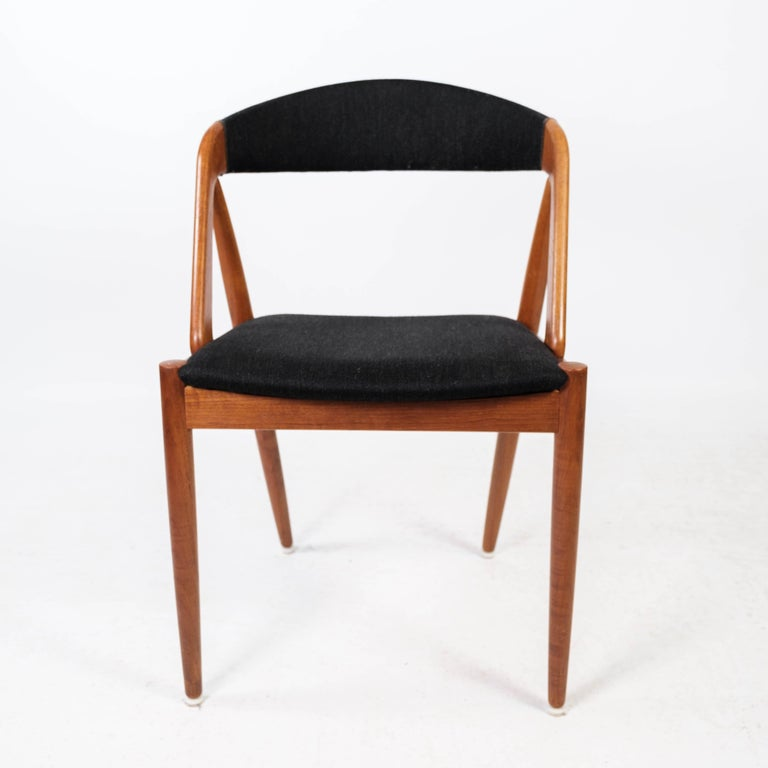 Dining room chair, model 31, designed by Kai Kristiansen in 1956 and manufactured by Schou Andersen in the 1960s. The chair is of teak and upholstered in black fabric.