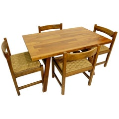 Dining Room Furniture Including a Table and Four Chairs by Giovanni Michelucci