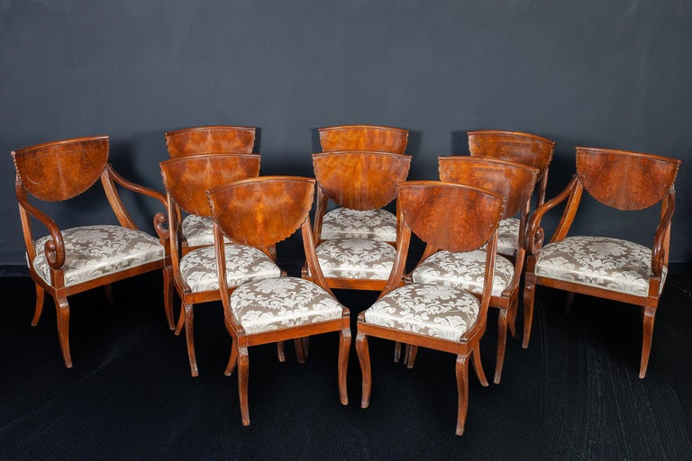 A fine set of Nord-Italian walnut chairs (8) and a pair of armchairs, Covered in ivory color silk in perfect condition. Lombardy Nord Italy, last quarter of the 18th century.