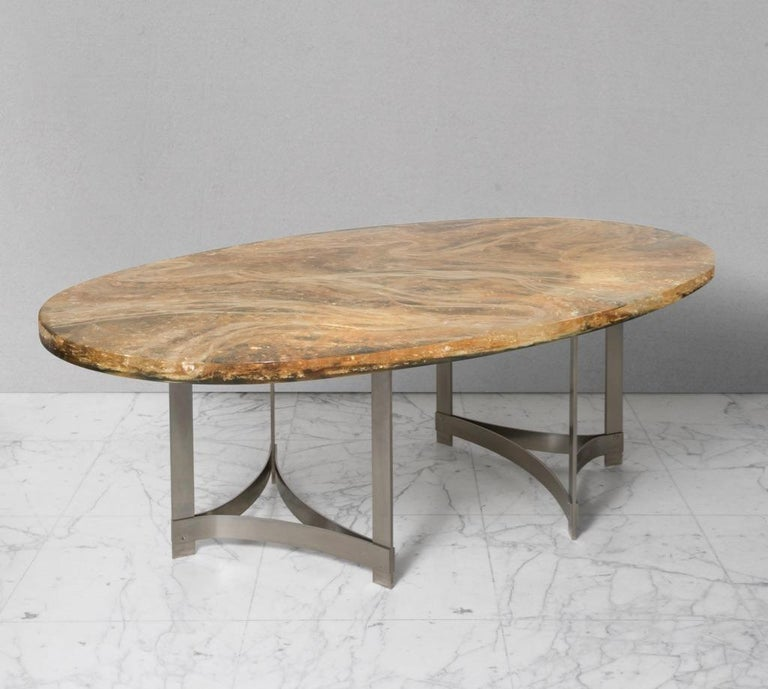 Oval table surface in fractal resin Table legs and struts in stainless steel Artist signature on the edge of the surface.