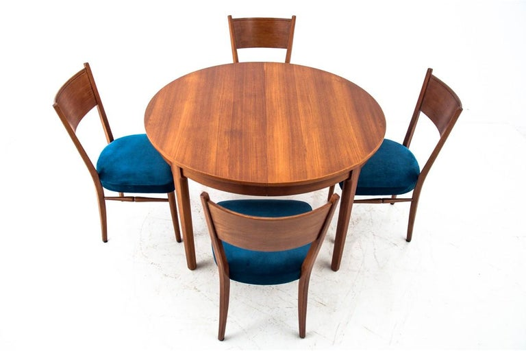 Dinner set, Danish design, 1960s  Very good condition, after renovation and replacement of upholstery.  Wood: teak  Dimensions:  Chairs height 88 cm, seat height 43 cm, width 46 cm, depth 55 cm  table avg. 115 cm height 73 cm, width when