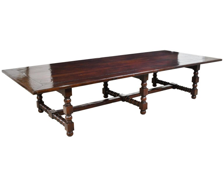 A beautiful and well-crafted dining set comprising of a 12-foot long dining table, (2) armchairs and (8) side chairs from 2005. The table is made of solid mahogany with a 1 1/2