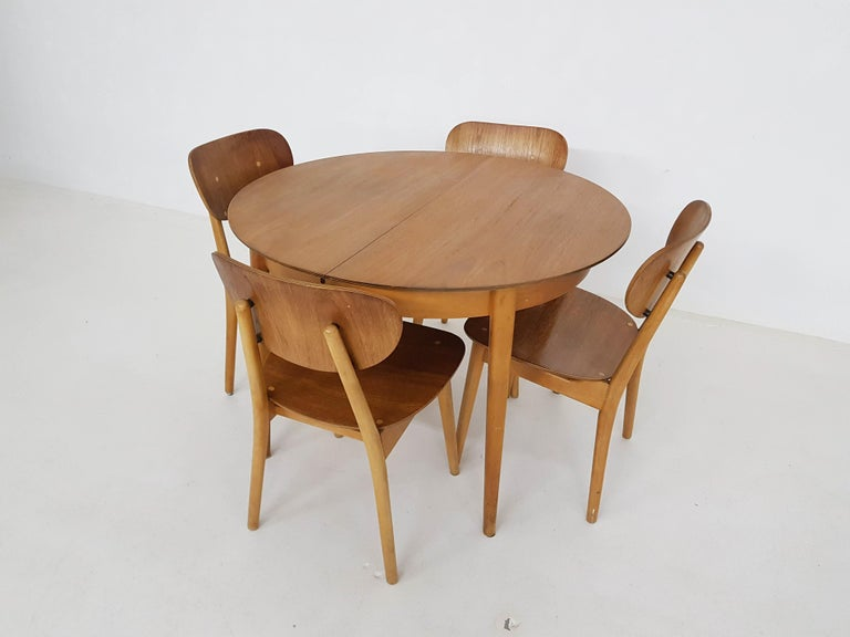 Matching dining set consisting of a TB35 table and SB11 chairs by Dutch designer Cees Braakman for UMS Pastoe.  Cees Braakman was a Dutch furniture designer who worked for UMS Pastoe in the mid-century. He designed many beautiful pieces with the
