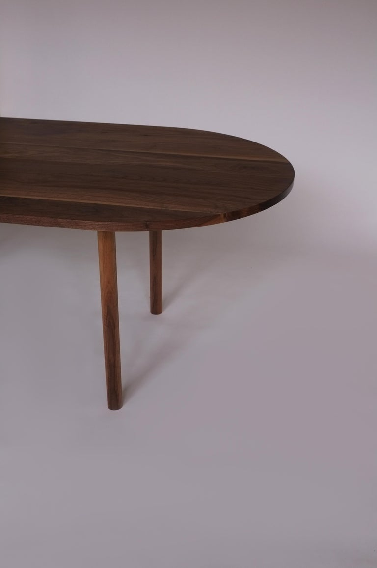 Dining Table by Campagna, Contemporary Minimal Pill Shaped Walnut Wooden Table In New Condition For Sale In Portland, OR
