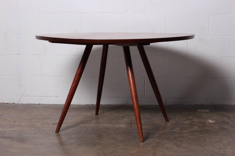 A walnut dining table with cherry legs by George Nakashima. All original with documentation from 1952.