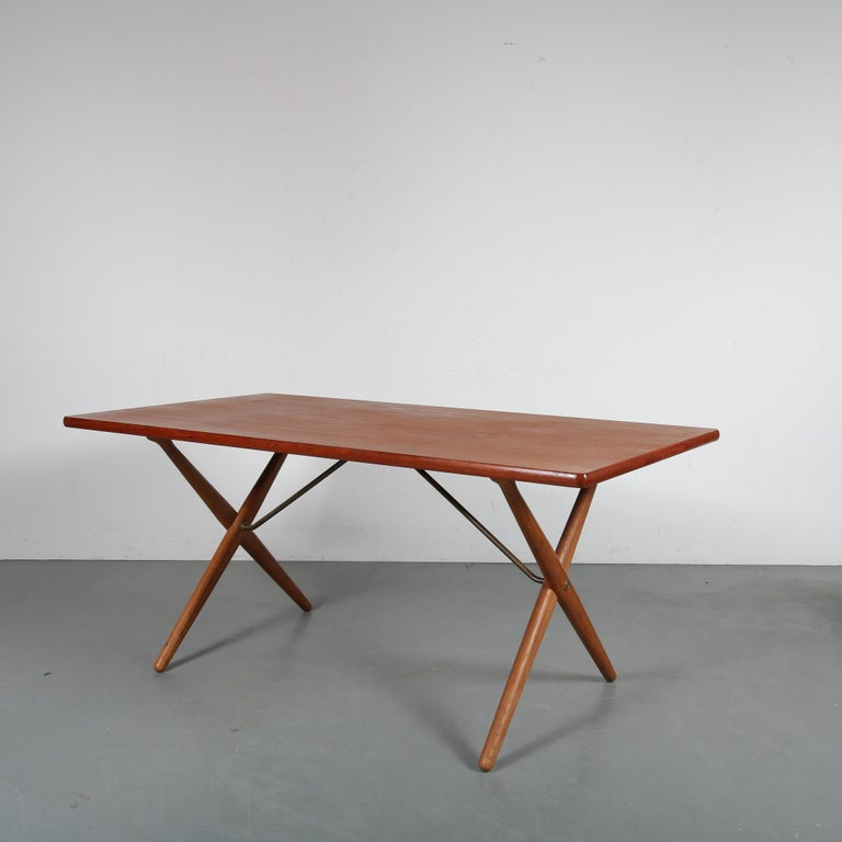 Beautiful teak dining table designed by Hans J. Wegner, manufactured by Andreas Tuck in Denmark, circa 1950.