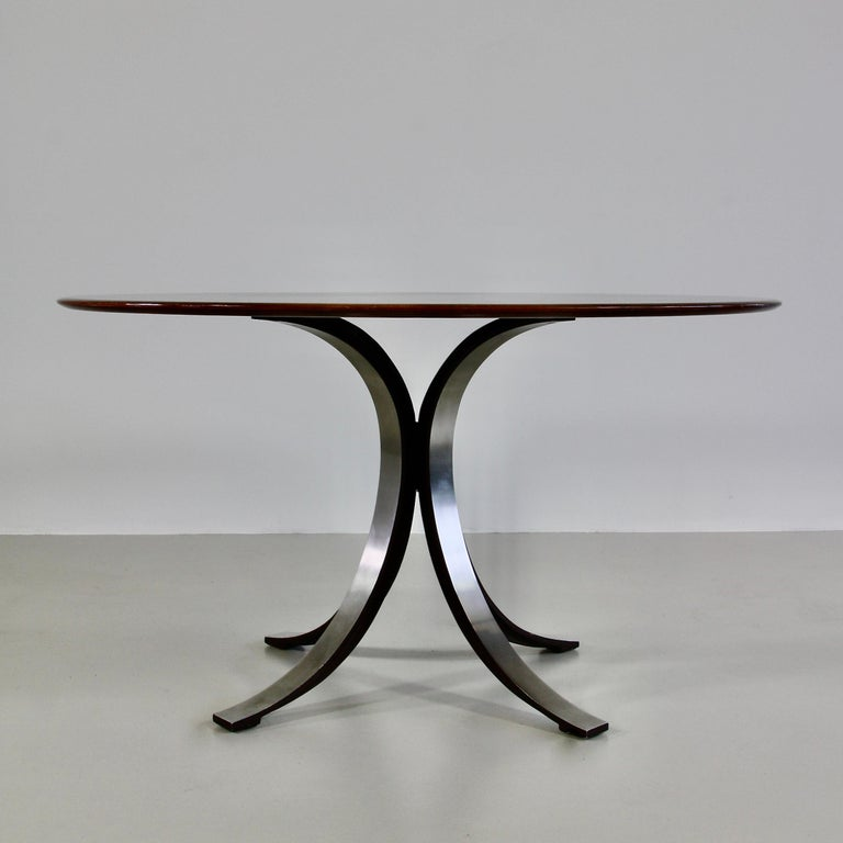 Round dining table (T69A) designed by Osvaldo Borsani in 1963-1964. Produced by TECNO.  Brushed metal base with the inner sides finished in matt dark brown enamel. Original wooden round table top.  Literature:  - Repertorio del Design