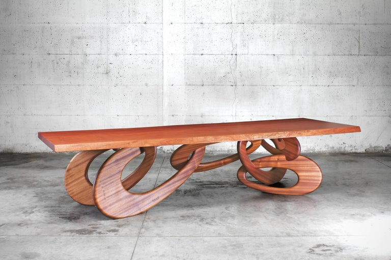 The chained up dining table is an important dining table with structure and top in rare one-piece slab mahogany (origin: Africa). Dining table dimension: L 320 x W 115 x H 76 cm. Each table is hand signed and numbered by the artists (engraved). 100%